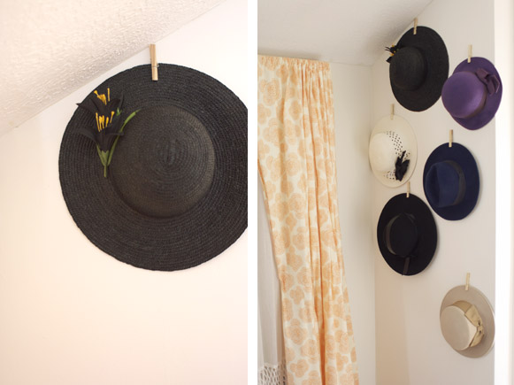 Clip the clothespin which now has an adhesive strip attached to its back  and attach it to the hat you will be hanging at the top. Hold it next to  the wall ...