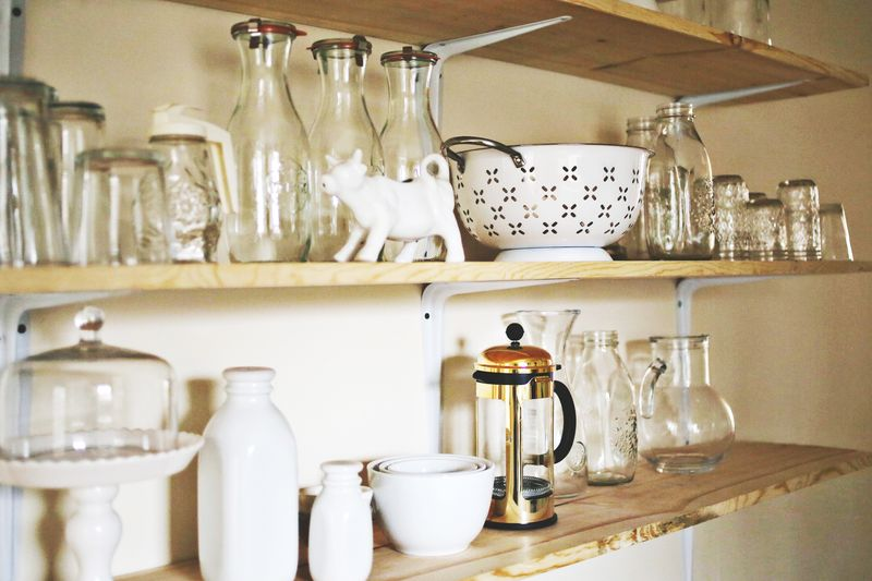 White dishes + unfinished wood shelves!