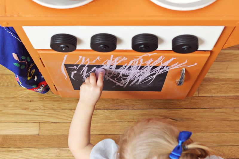 Chalkboard door on adorable kid's kitchenette