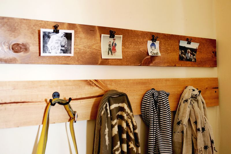 Photos + coat racks inside the mudroom door