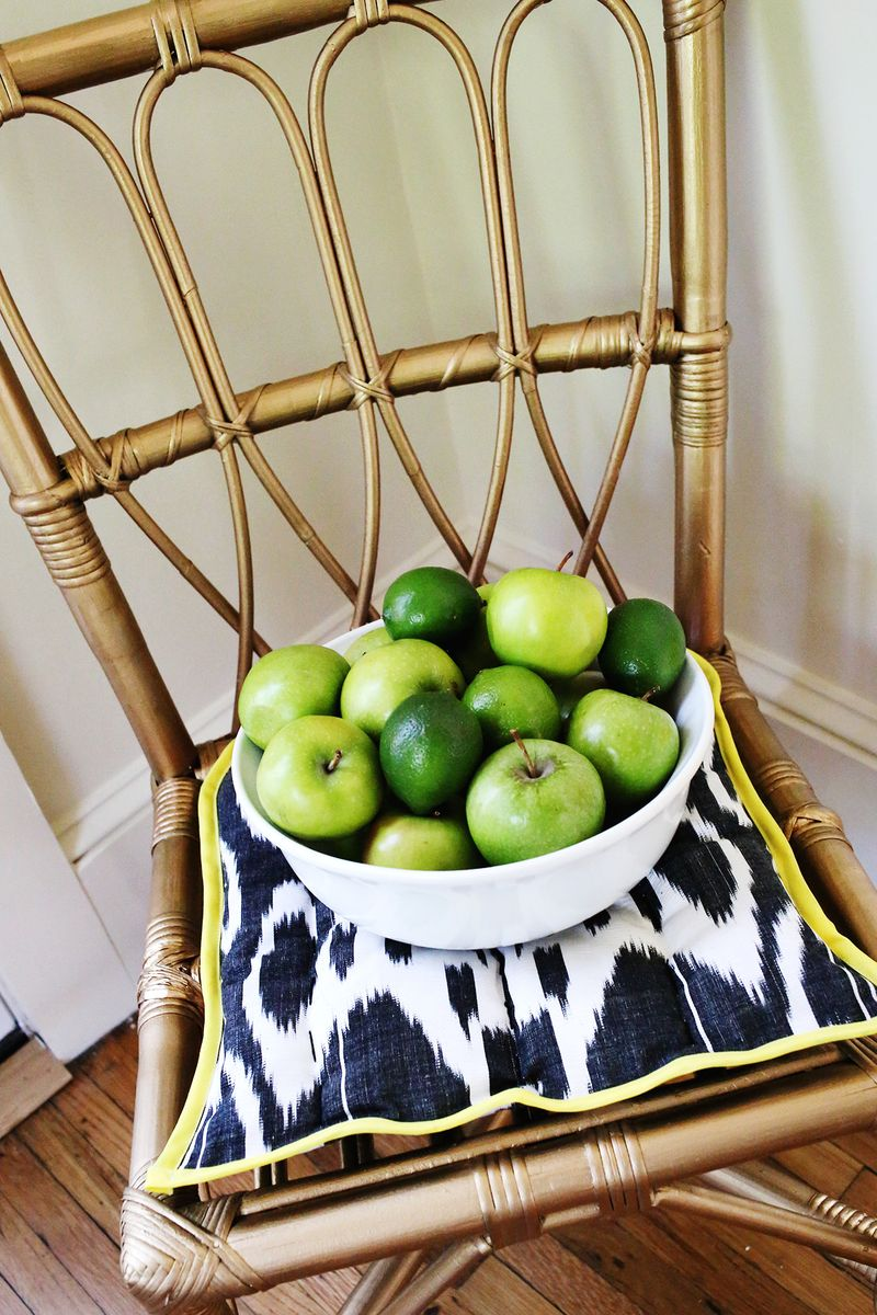 Old wicker chair painted with Martha Stewart liquid gilding… so pretty!