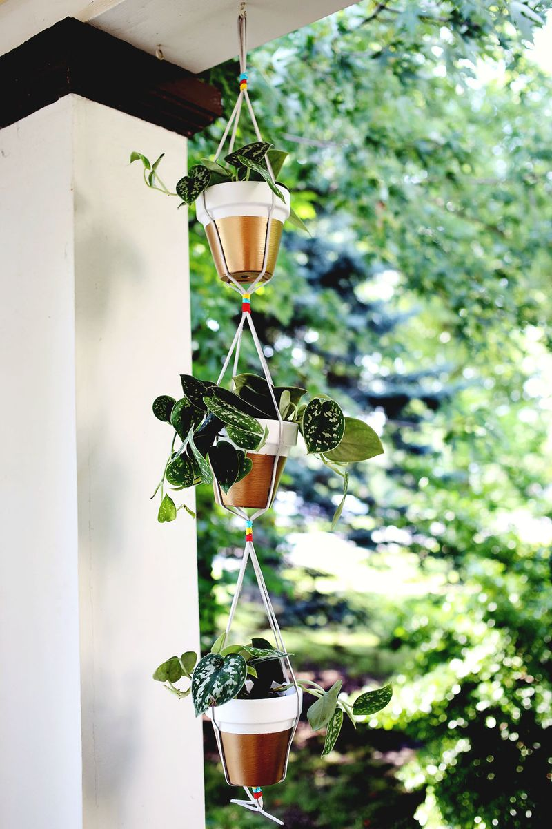 Gold Dipped Hanging Planters www.abeautifulmess.com