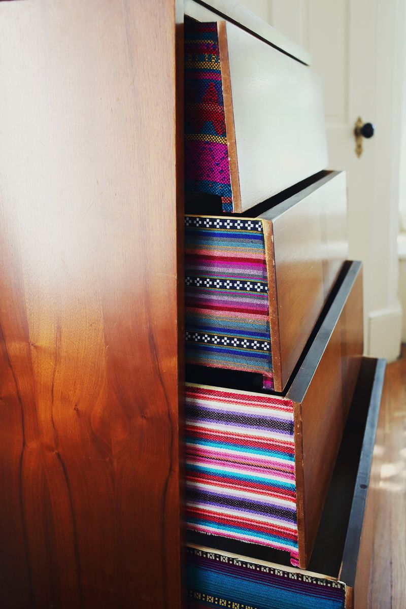 Try this: Fabric lined dresser drawers