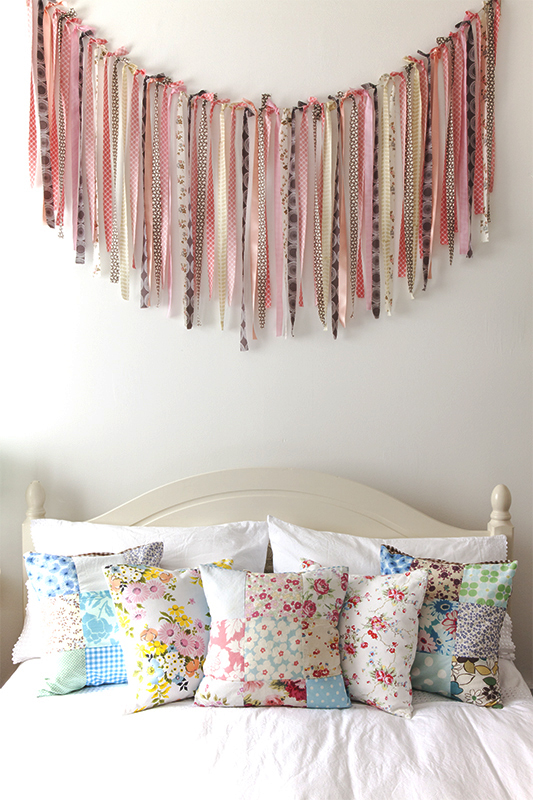 Fabric streamer bunting above the bed!