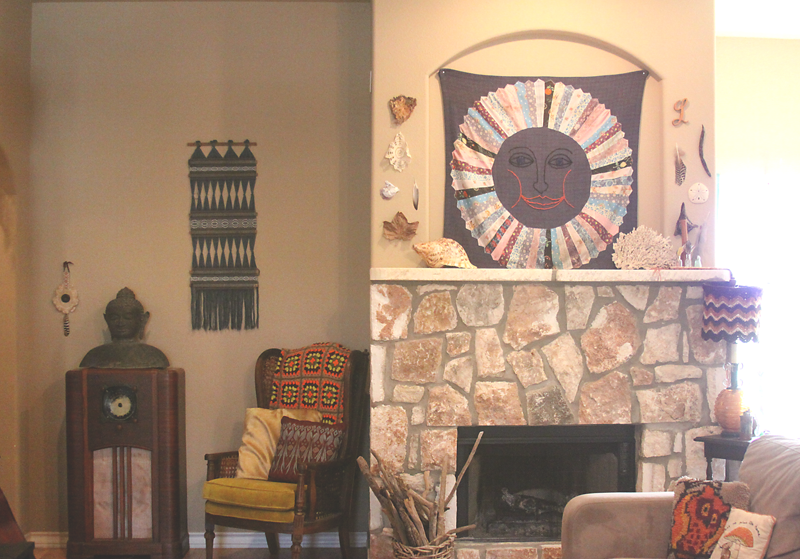 Love the homemade tapestry above the fireplace
