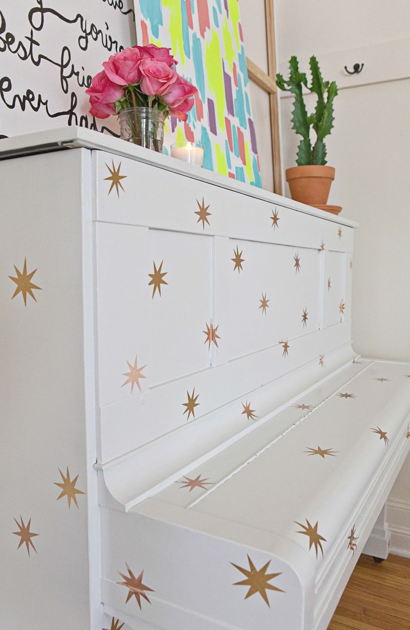 White piano with temporary stars for the holidays!
