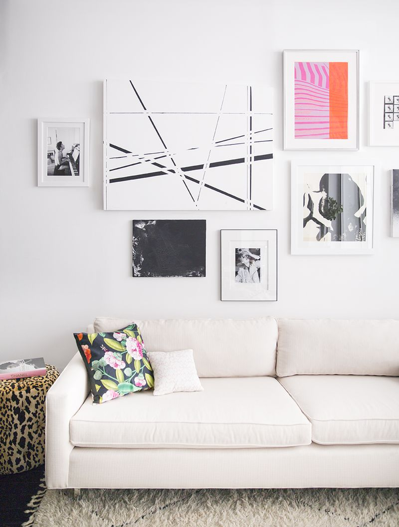 Love the white couch and gallery wall!