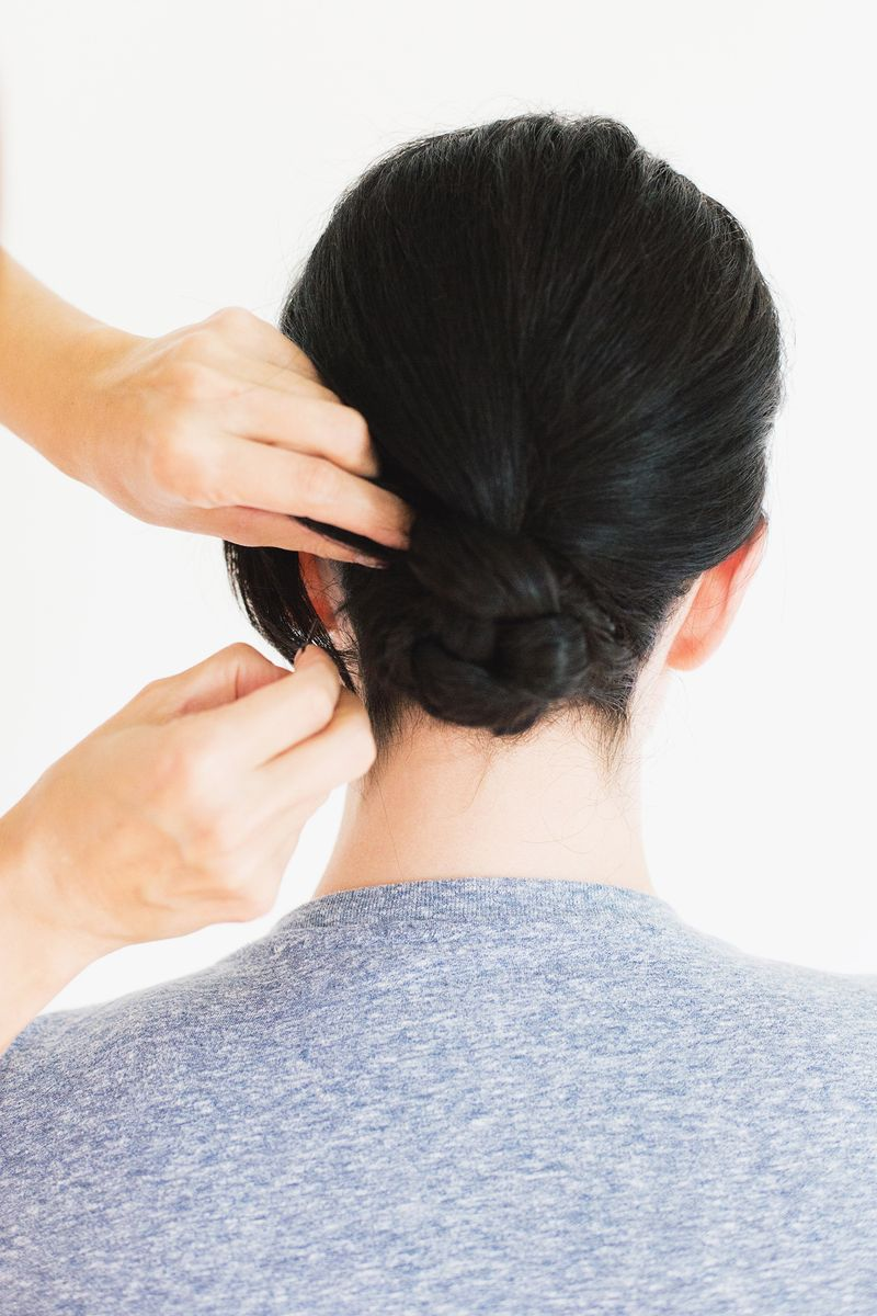 Step four- keep pinning under all loose hair is hidden