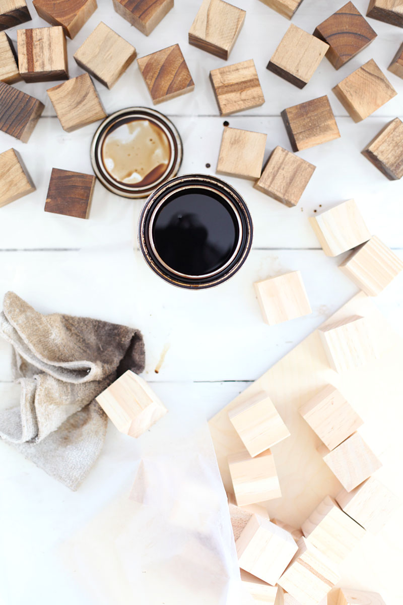 Create a wooden mosaic wall art with simple supplies you can find at the craft store! Click through for instructions.