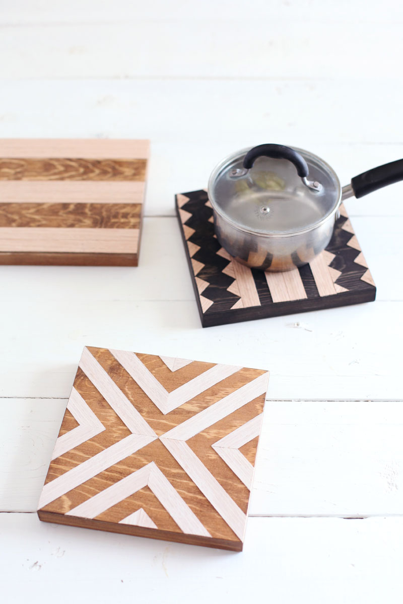 Geometric wood trivets— Easy to make, and great kitchen wall decor too!