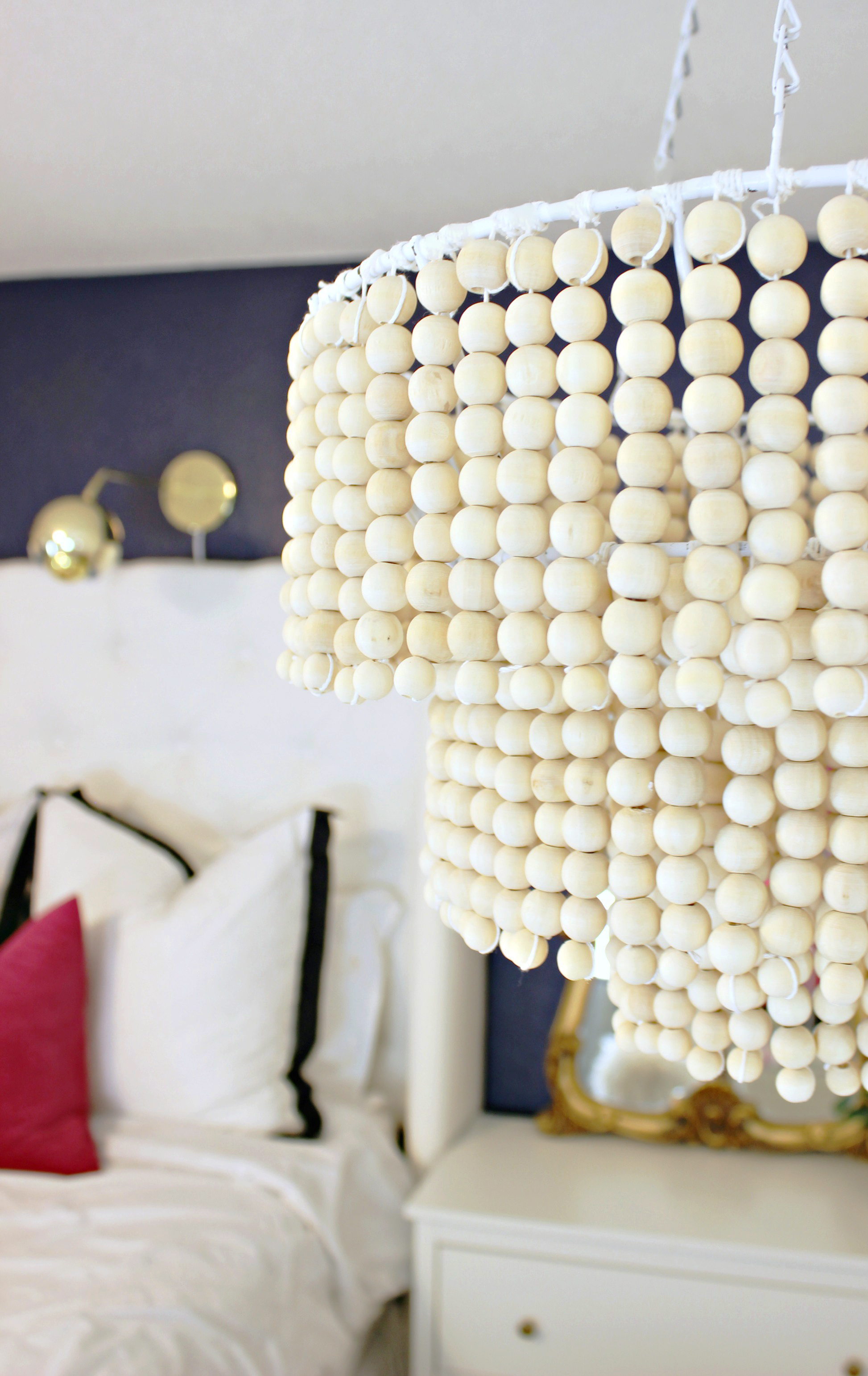 Love this DIY Wood Bead Chandelier - Click for tutorial
