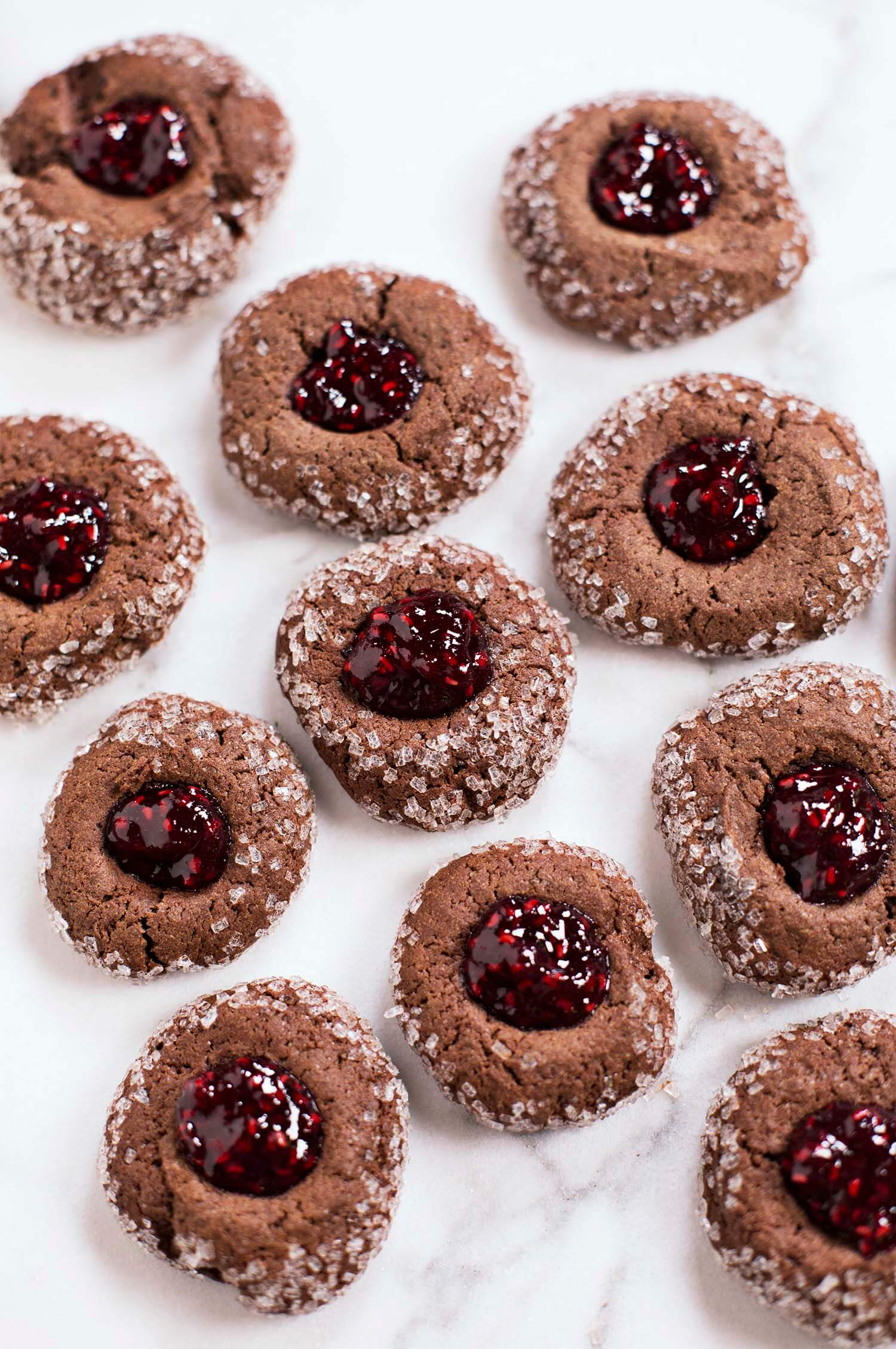 Chocolate thumbprint cookies with red wine raspberry jam (via abeautifulmess.com)