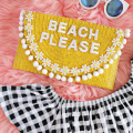 Try This: Turn a Simple Straw Clutch into the Perfect Vacation Bag! - March 06, 2017