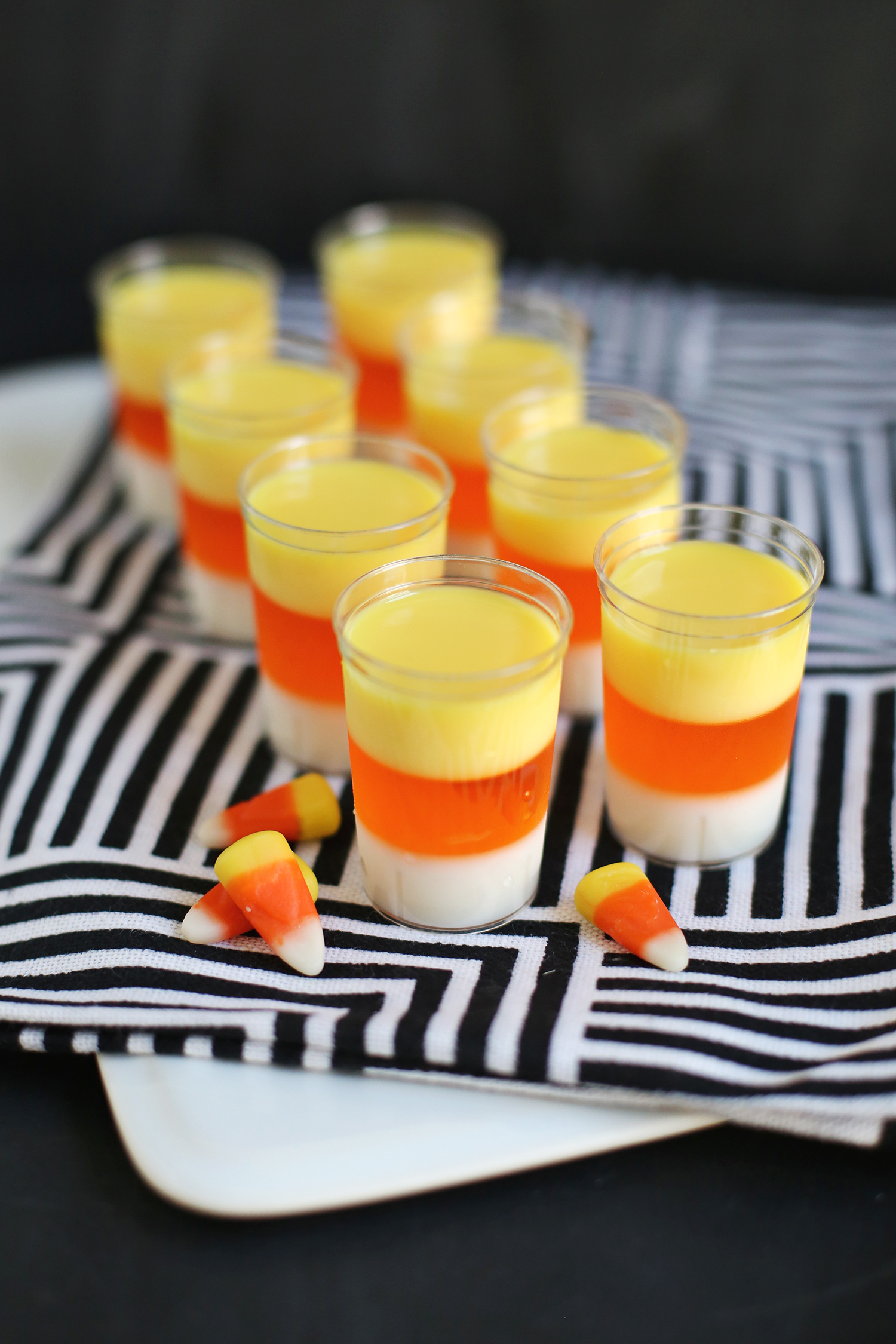 Yessss!! Candy Corn Jello Shots (click through for recipe)
