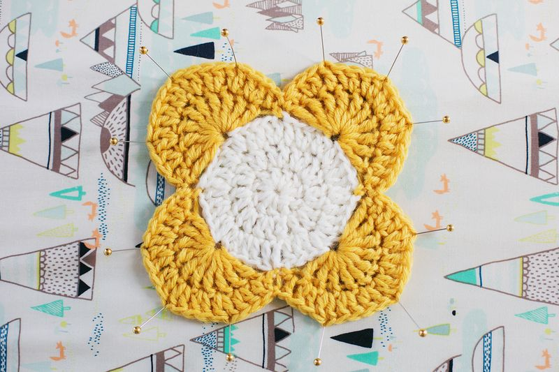 Use pins and an ironing board to block small crochet projects!