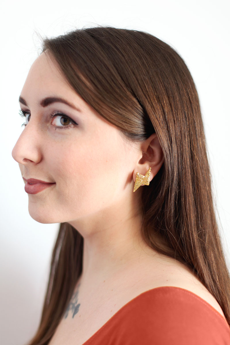 Glittery gold thunderbolt earrings