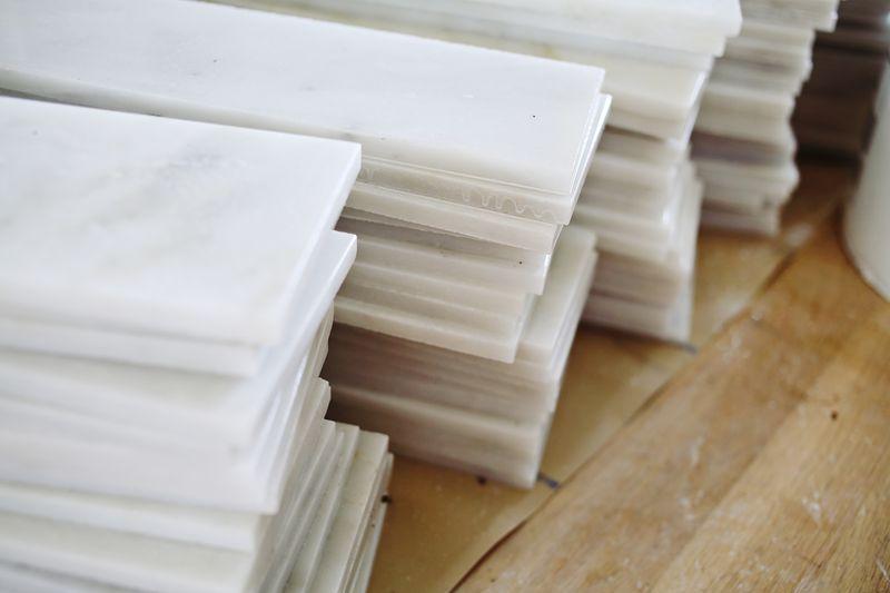 Cut 12x12 marble into 4x12 strips for herringbone pattern