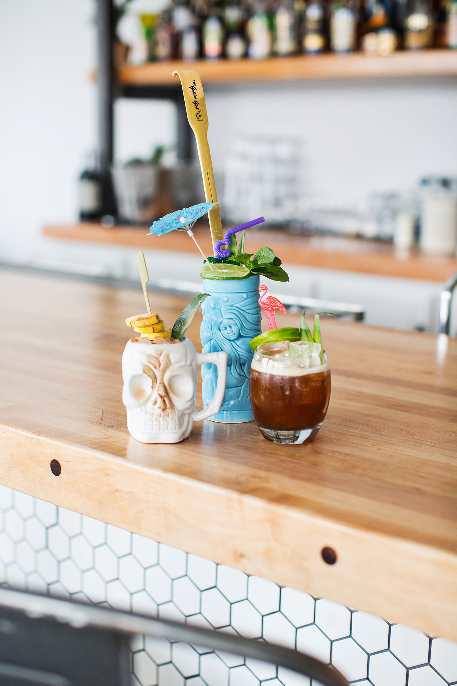 The Golden Girl Rum Club the itch cocktail with backscratcher