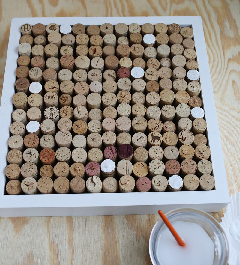 try this wine cork bulletin board a beautiful mess. Black Bedroom Furniture Sets. Home Design Ideas