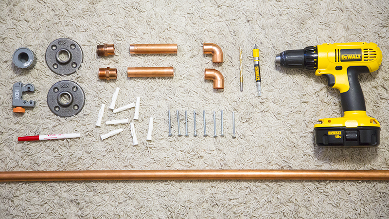 Hanging Copper Pipe Clothing Rack DIY (click through for tutorial)