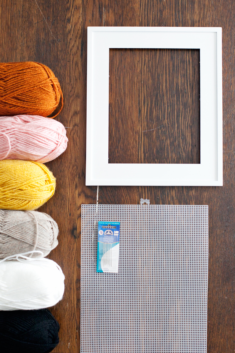 Use a plastic mesh canvas to create a decorative embroidery piece.