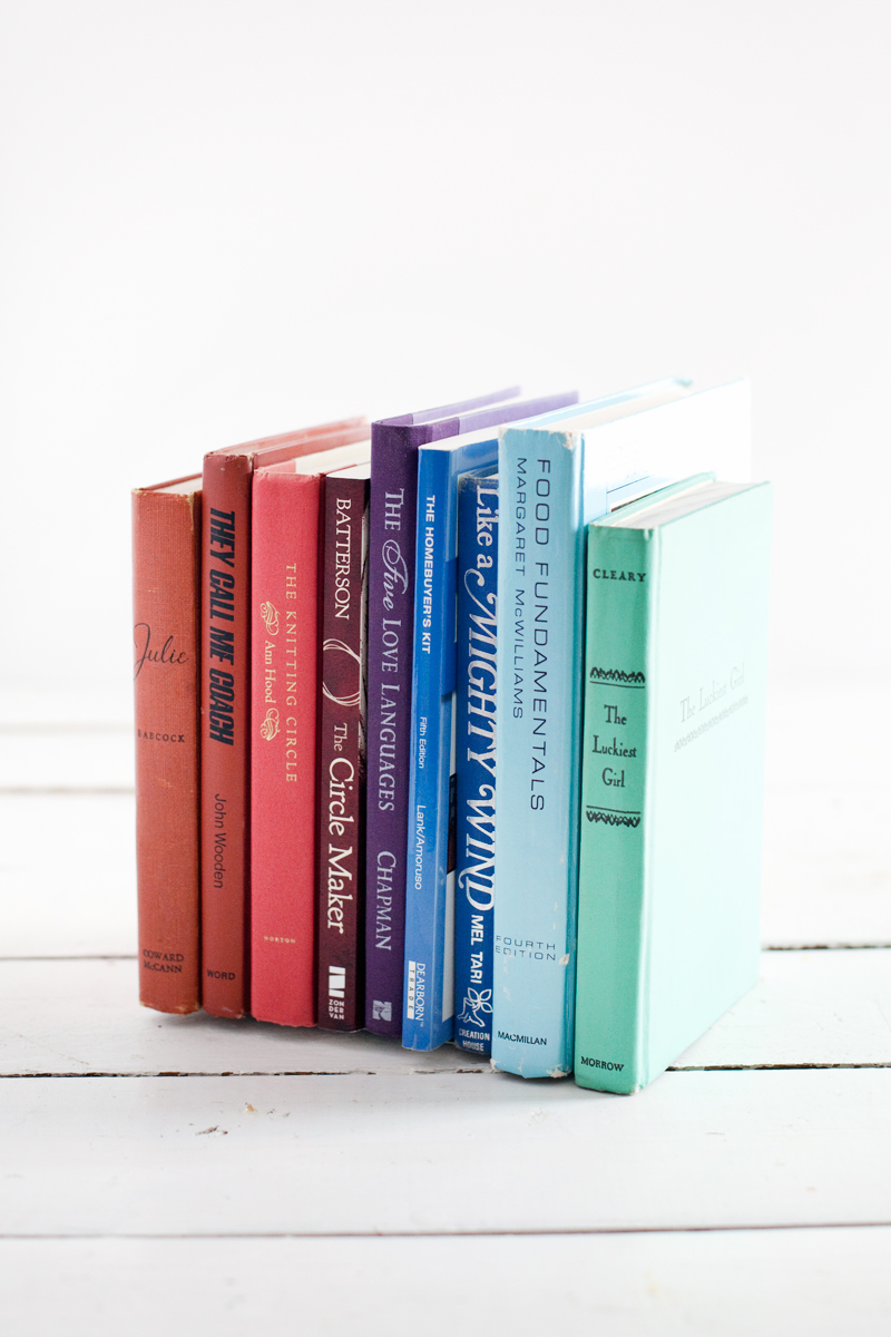 Turn discarded books into invisible bookends for a streamlined bookshelf display.