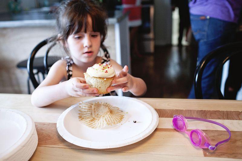 Penny enjoys a cupcake