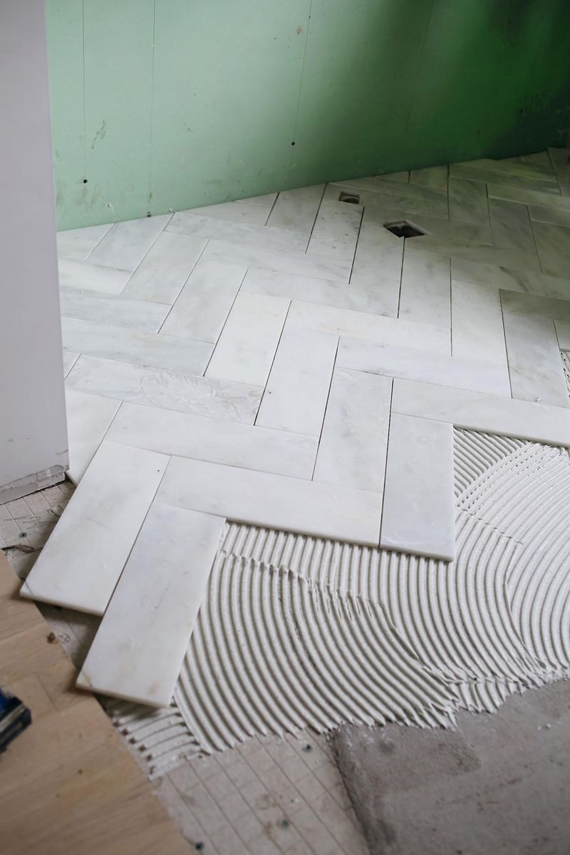 Try this herringbone marble tile a beautiful mess cut 12x12 marble into 4x12 strips for herringbone pattern dailygadgetfo Image collections