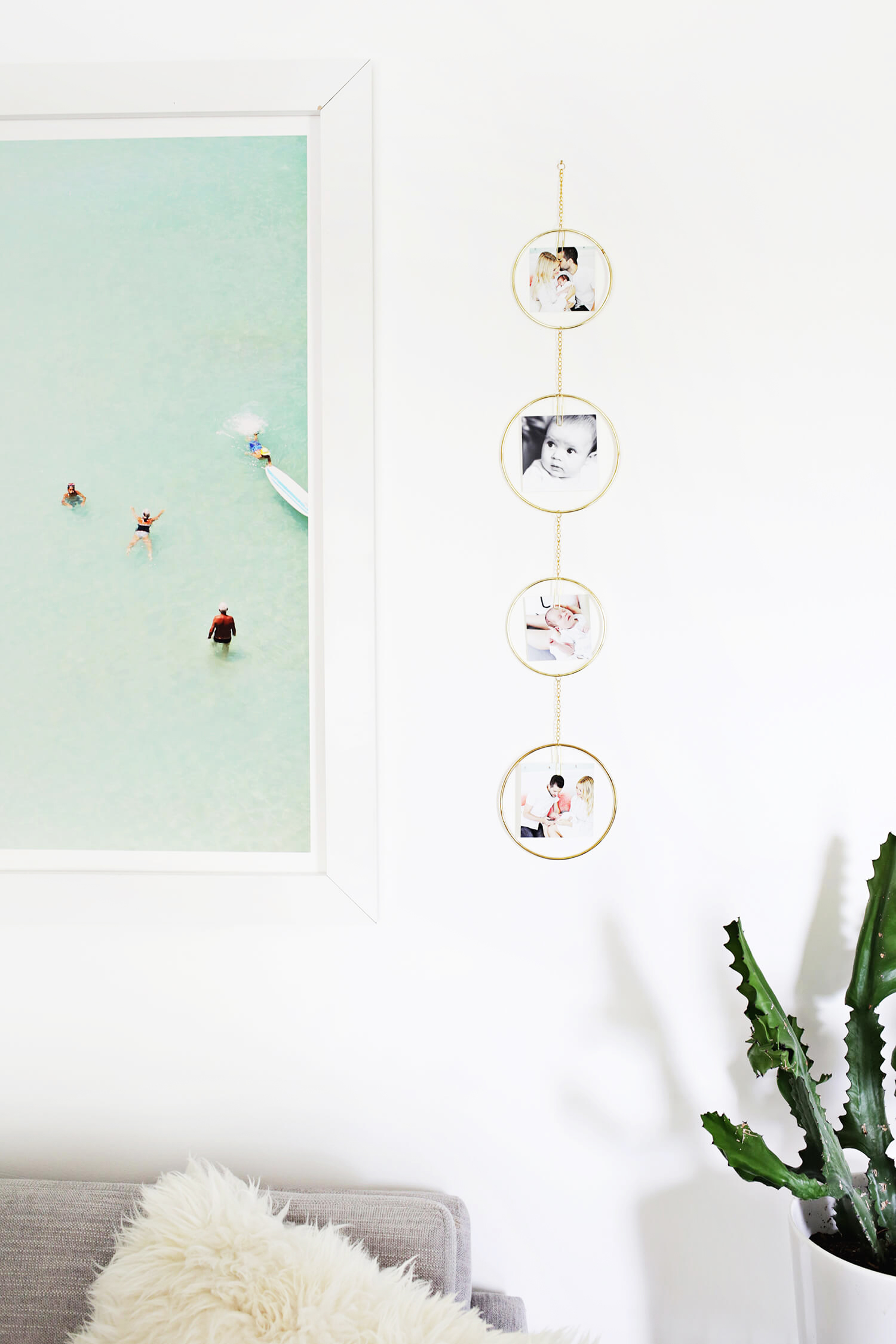 Great idea! Vertical Photo Display DIY (click through for tutorial)